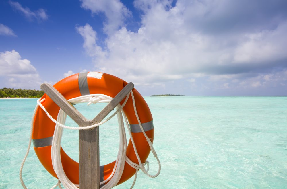A beautiful travel destinations and tropical beach with a buoy in the foreground.